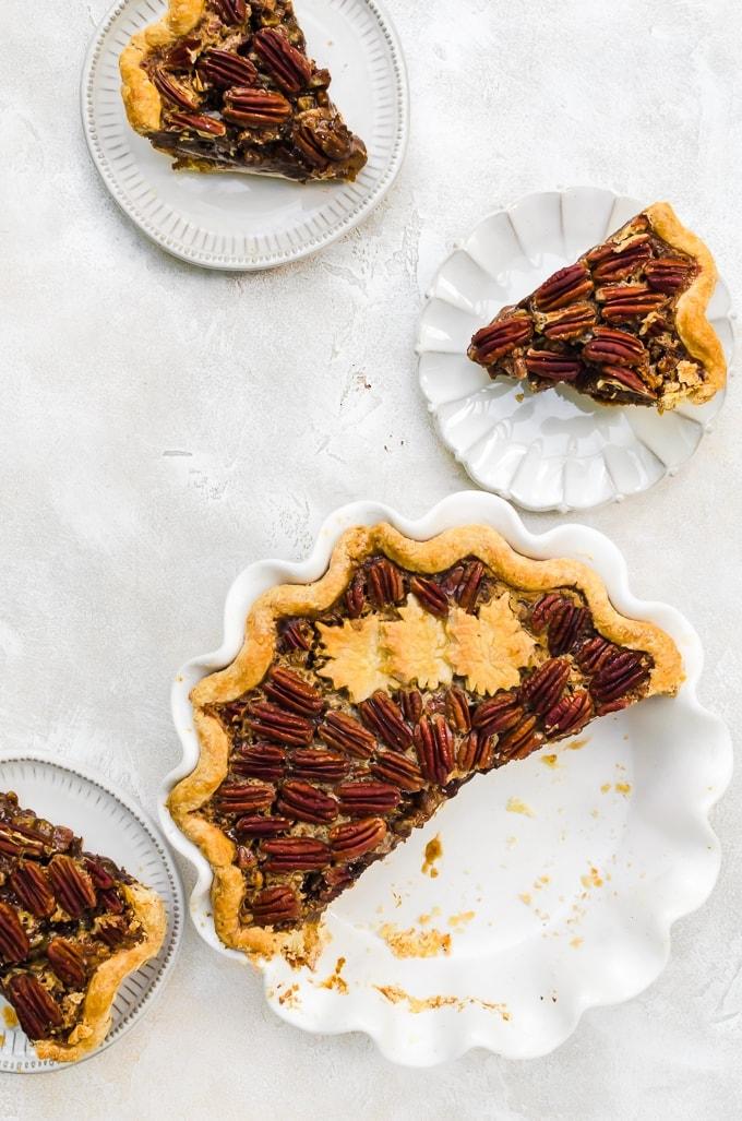 chocolate pumpkin pecan pie being served on plates