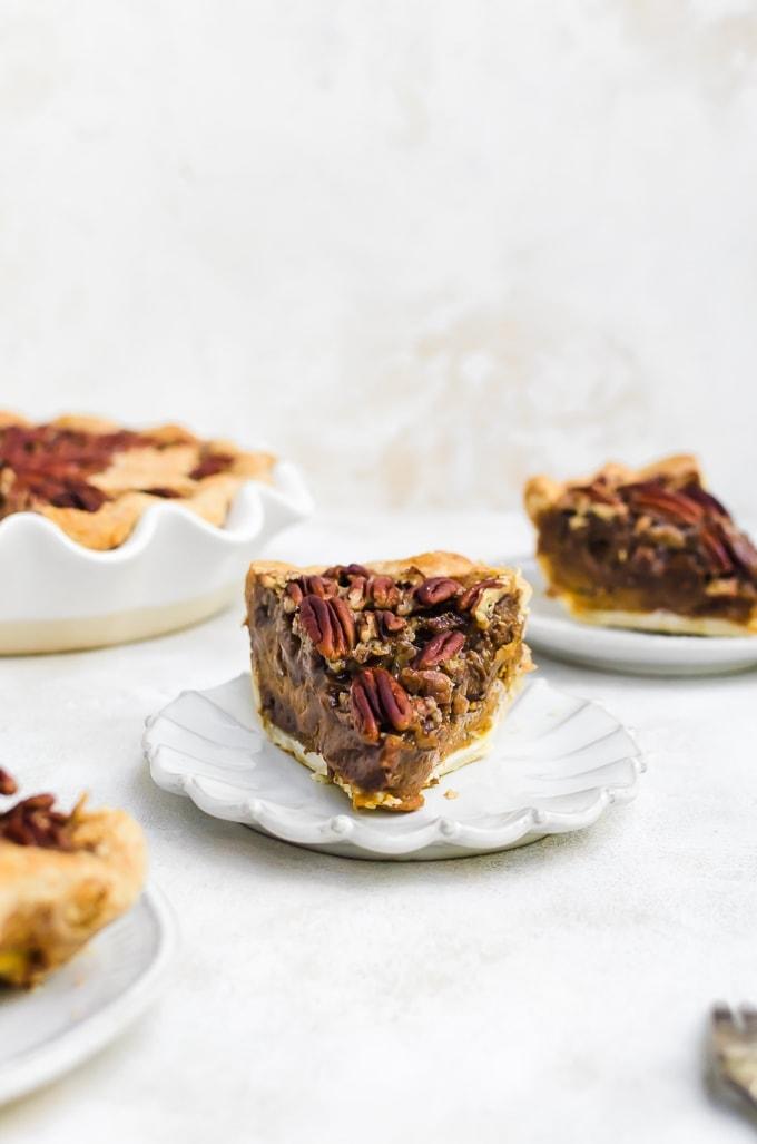chocolate pumpkin pecan pie slice on a plate