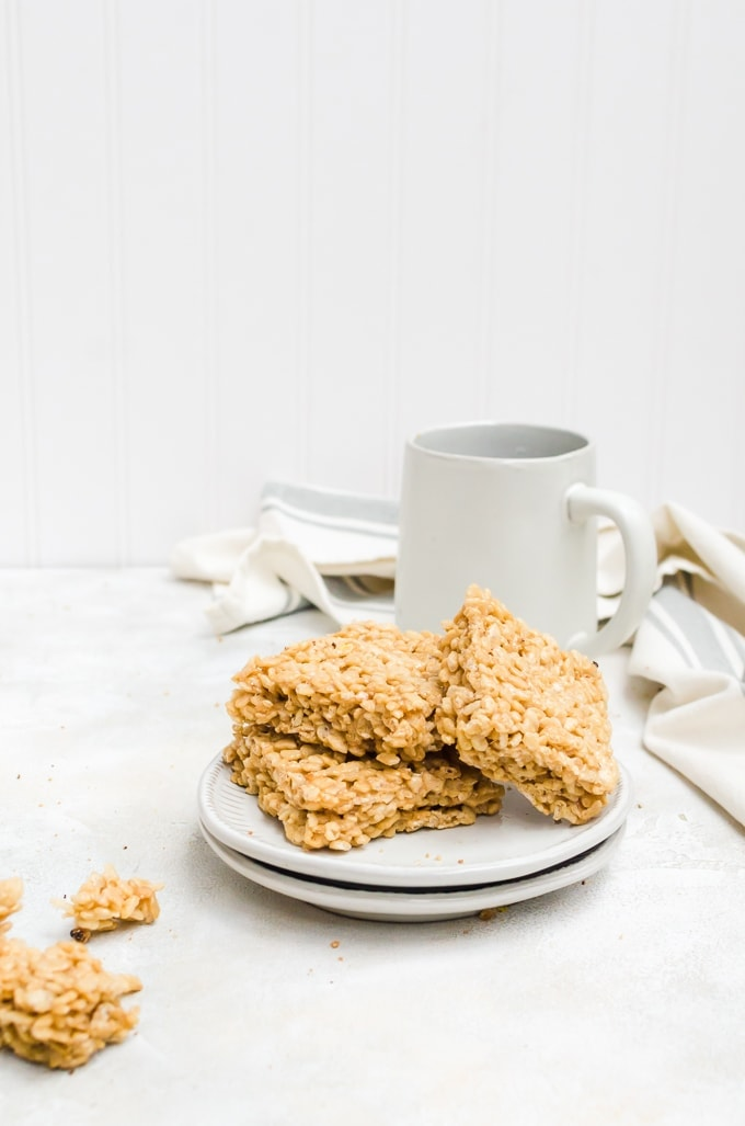 coffee rice crispy treats stacked on a plate with a mug of coffee