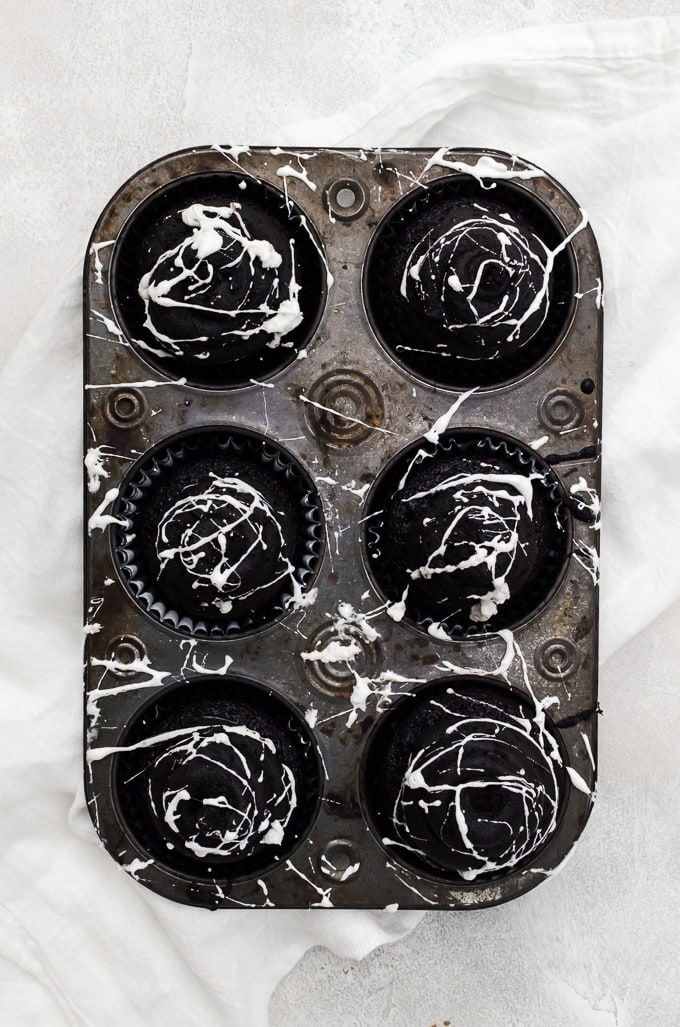 overhead spiderweb cupcakes in cupcake tin