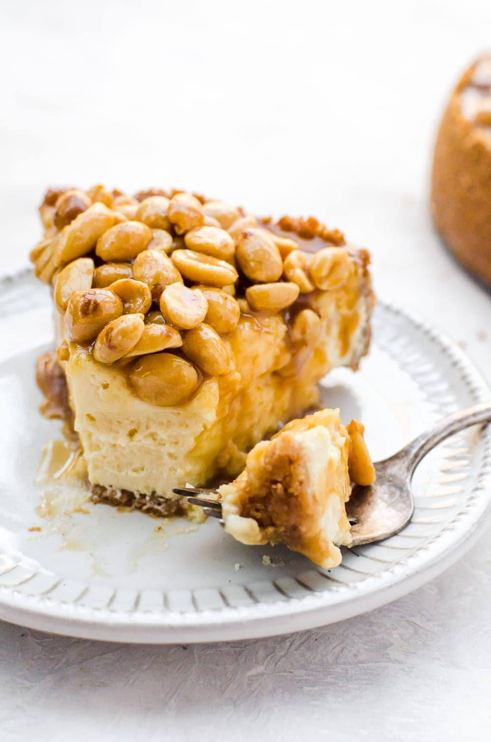 close up caramel nut cheesecake with fork