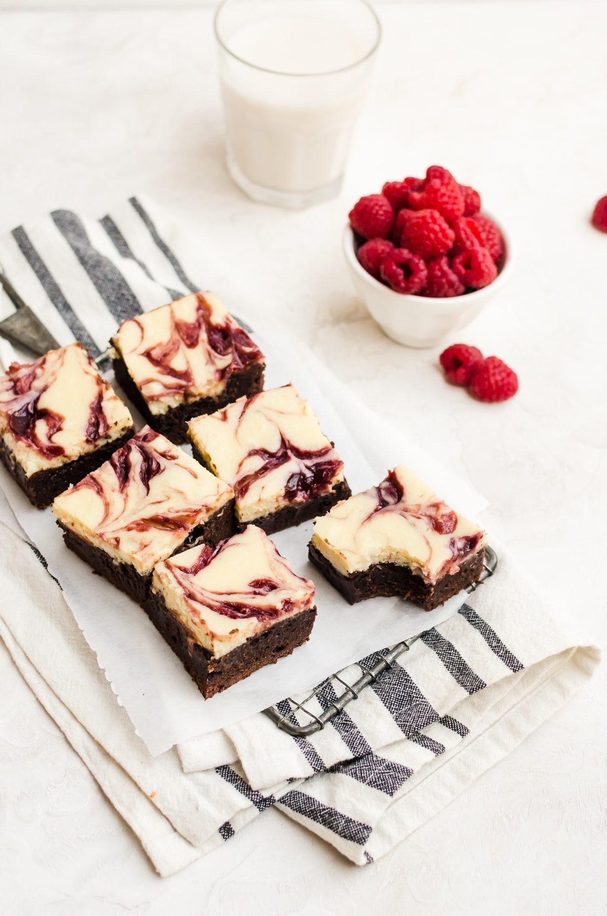 sliced raspberry cheesecake brownies