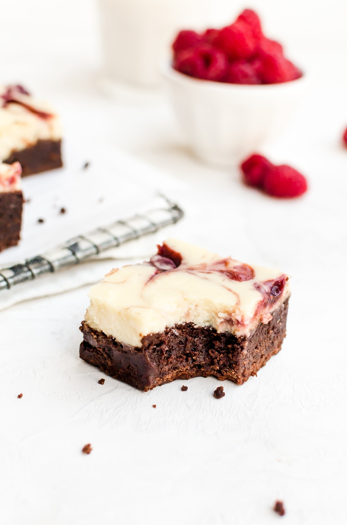 raspberry cheesecake brownie slice with bite