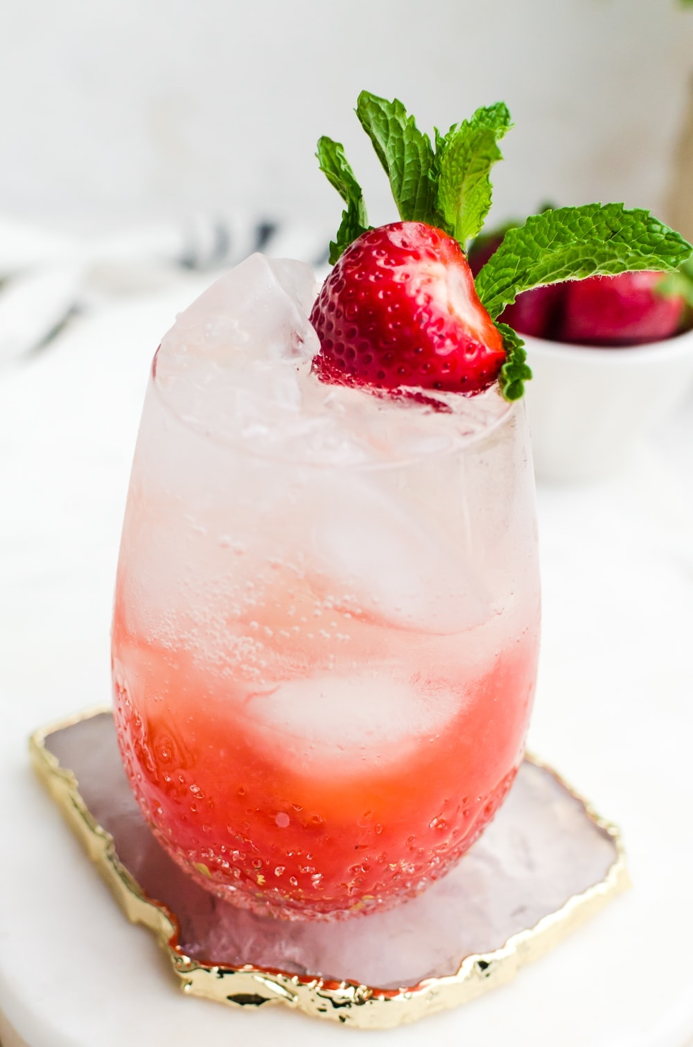 close up strawberry champagne mojito