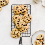 caramel stuffed chocolate chip cookies on a wire rack