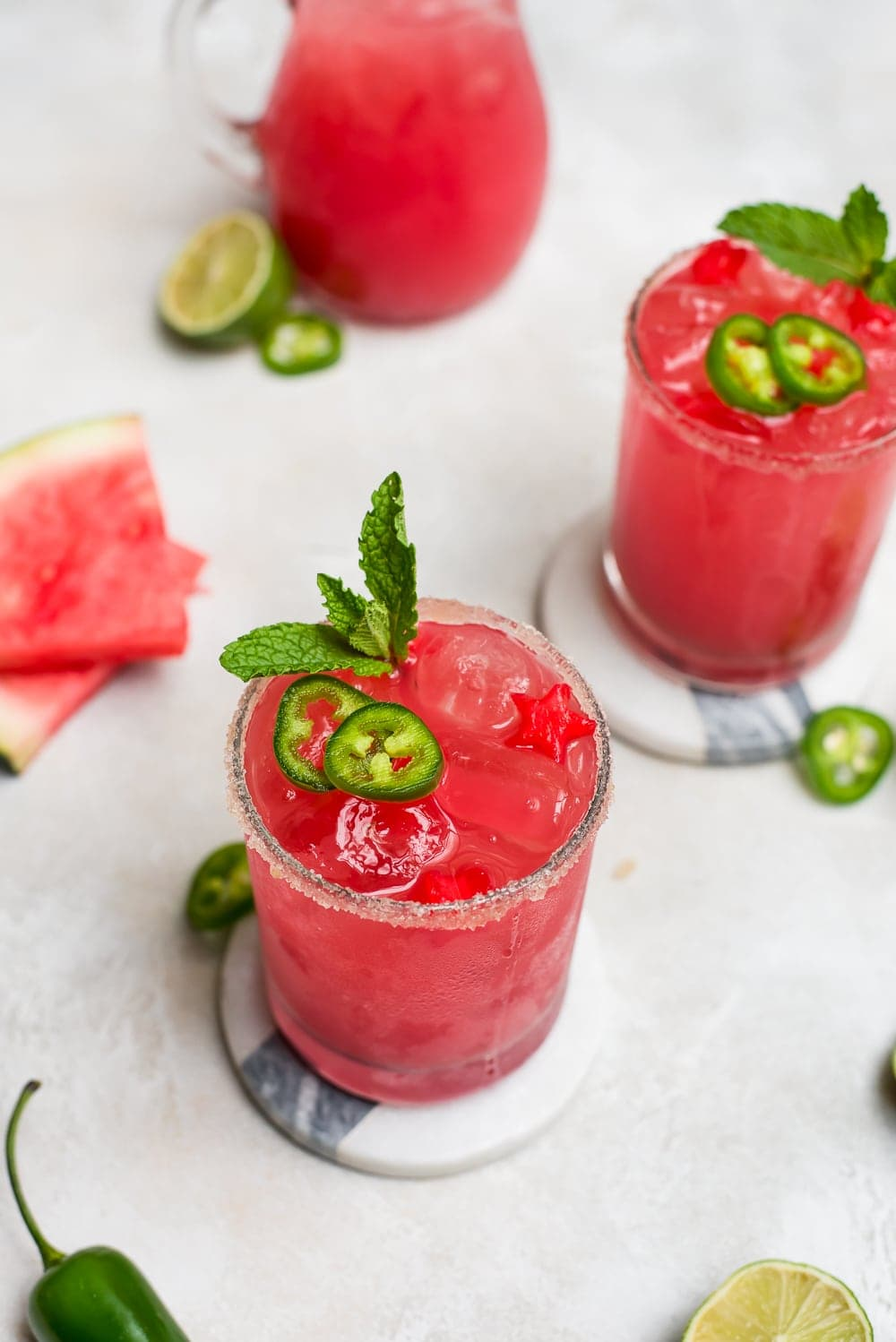 overhead watermelon margaritas with garnish and pitcher