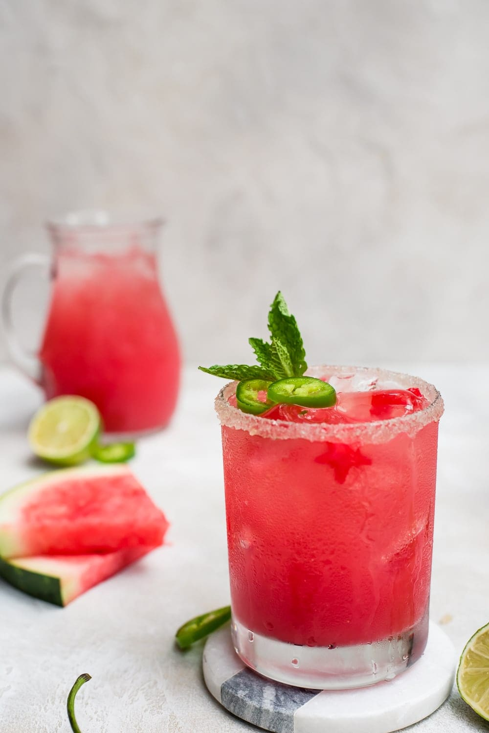 watermelon margarita next to sliced watermelon
