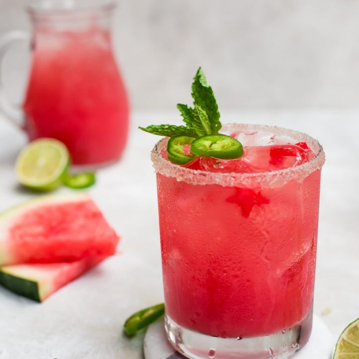 watermelon margarita with sliced watermelon and pitcher