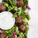 lamb meatballs in salad close up