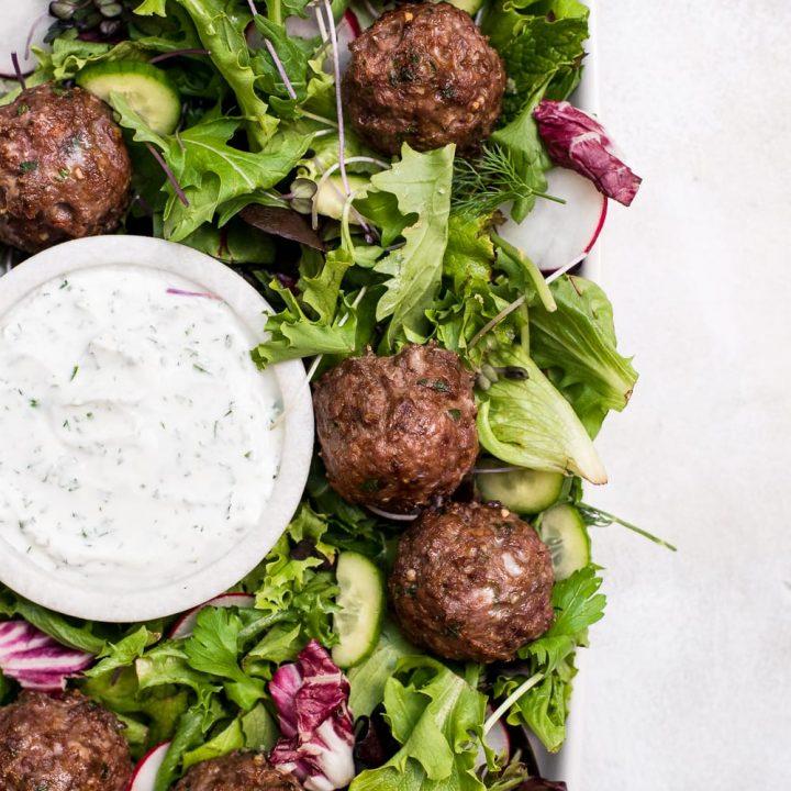 lamb meatballs in salad close up