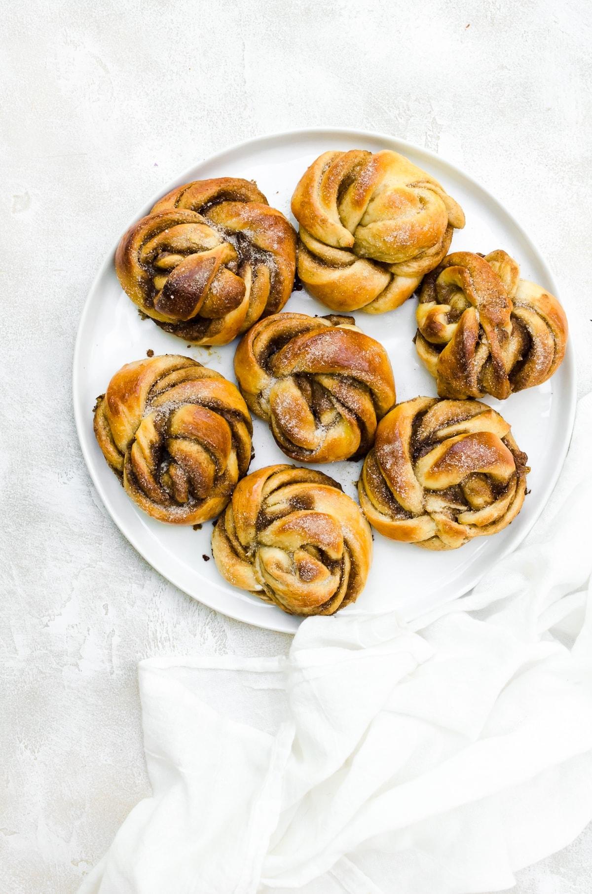 overhead cardamom buns on a plate