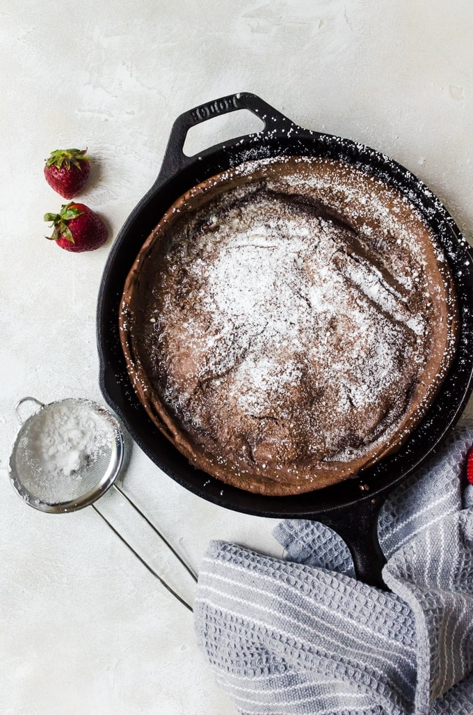 Chocolate dutch baby dusted with powdered sugar