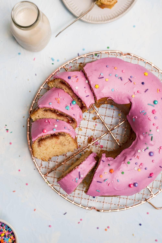 donut cake sliced for serving with extra sprinkles