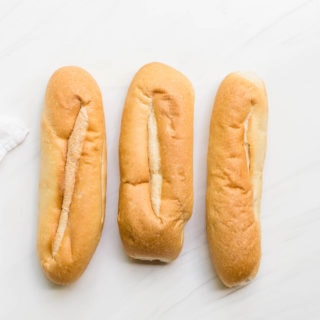 hoagie rolls lined up in a row overhead prep