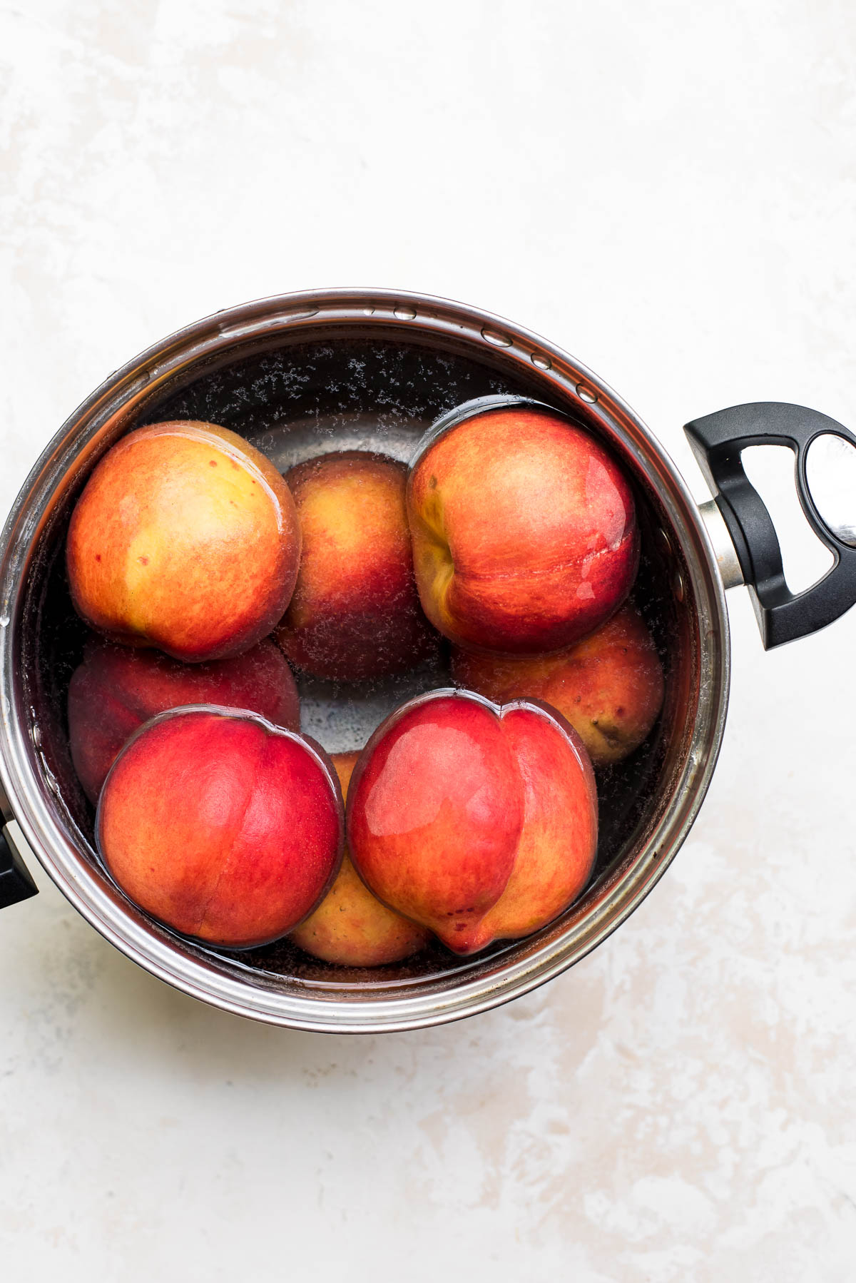 peach jam prep, blanching peaches in boiling water