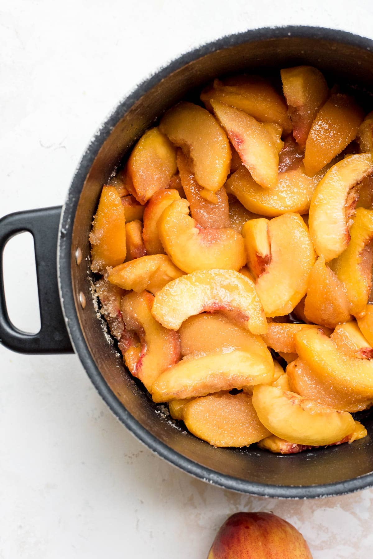 peach jam prep sliced peaches mixed with sugar, lemon juice, and salt in pot