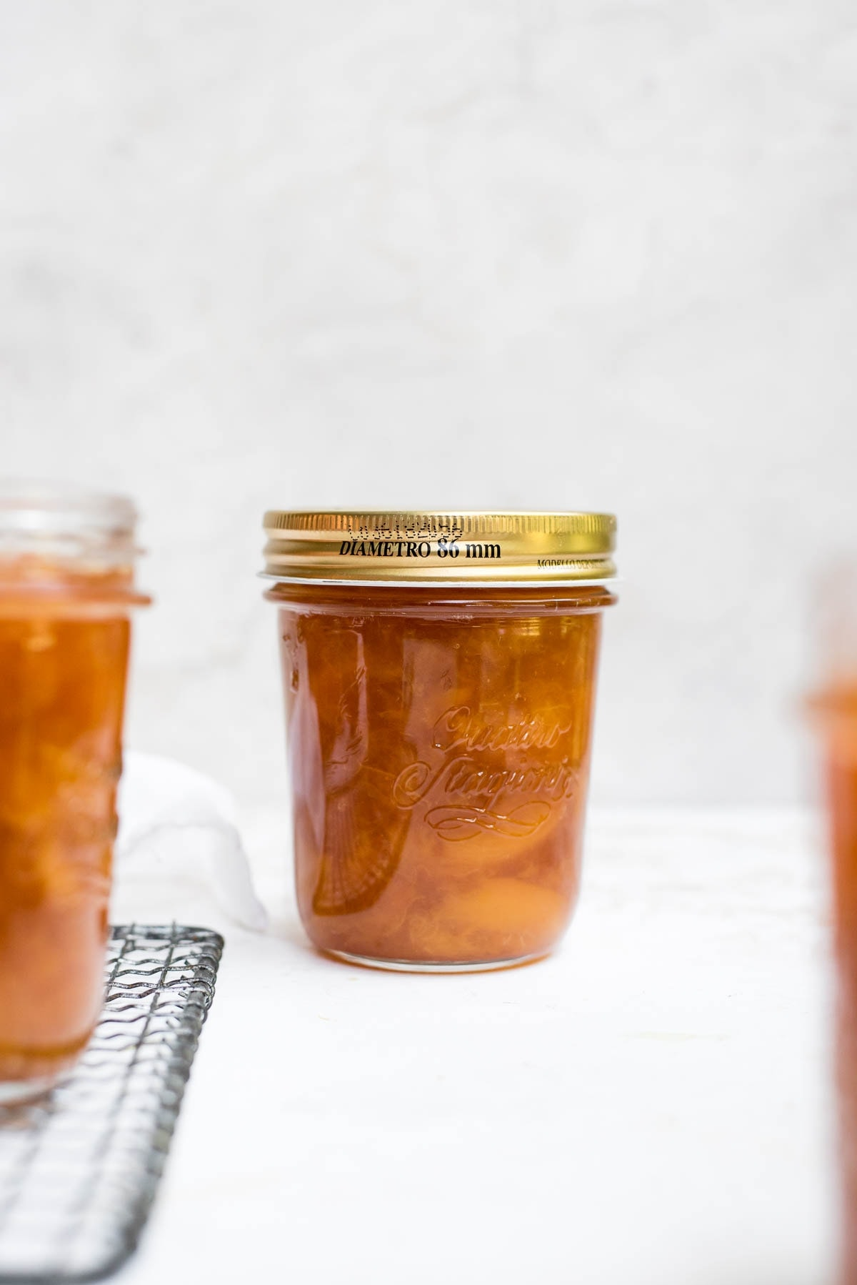 peach jam in jar with lid