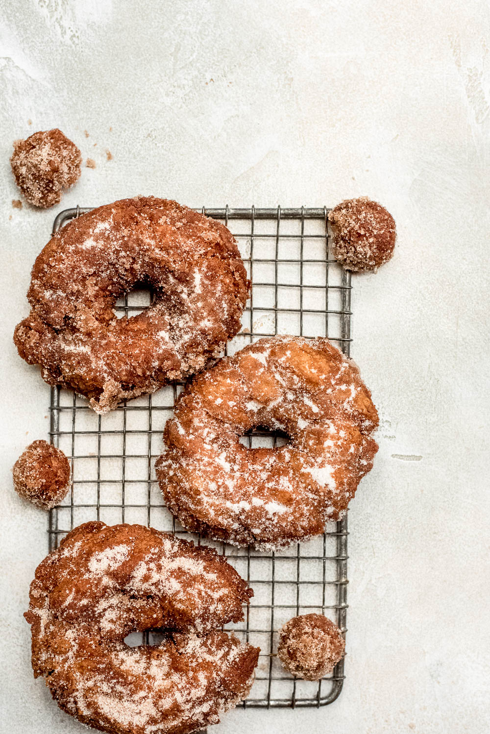 apple cider doughnuts on wire rack overhead