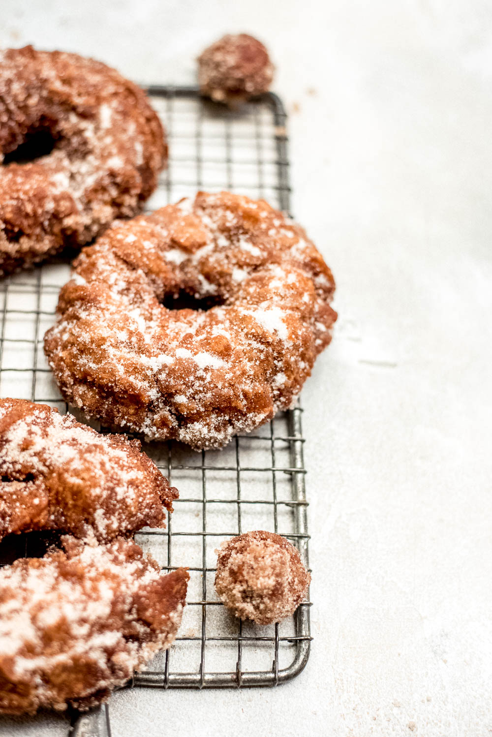 apple cider donuts close up on wire rack