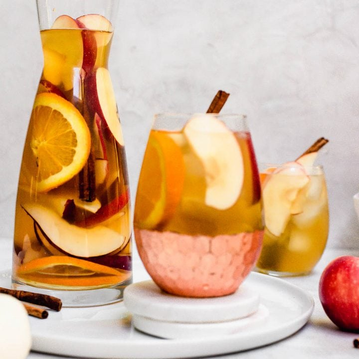 pitcher of apple cider sangria with filled glass
