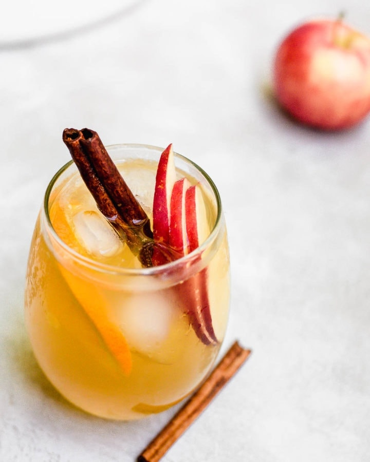 overhead apple cider sangria in glass with cinnamon garnish
