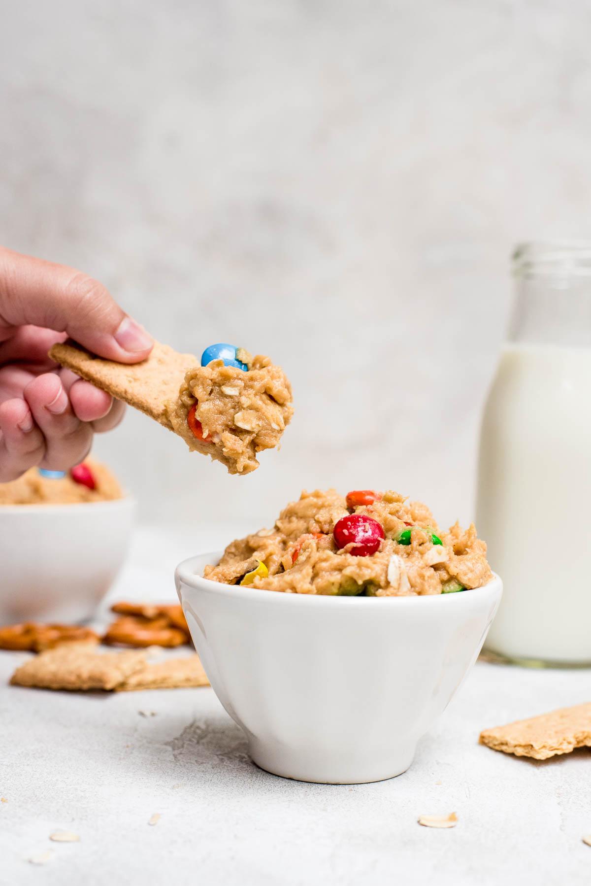 graham cracker dipped in cookie dough dip