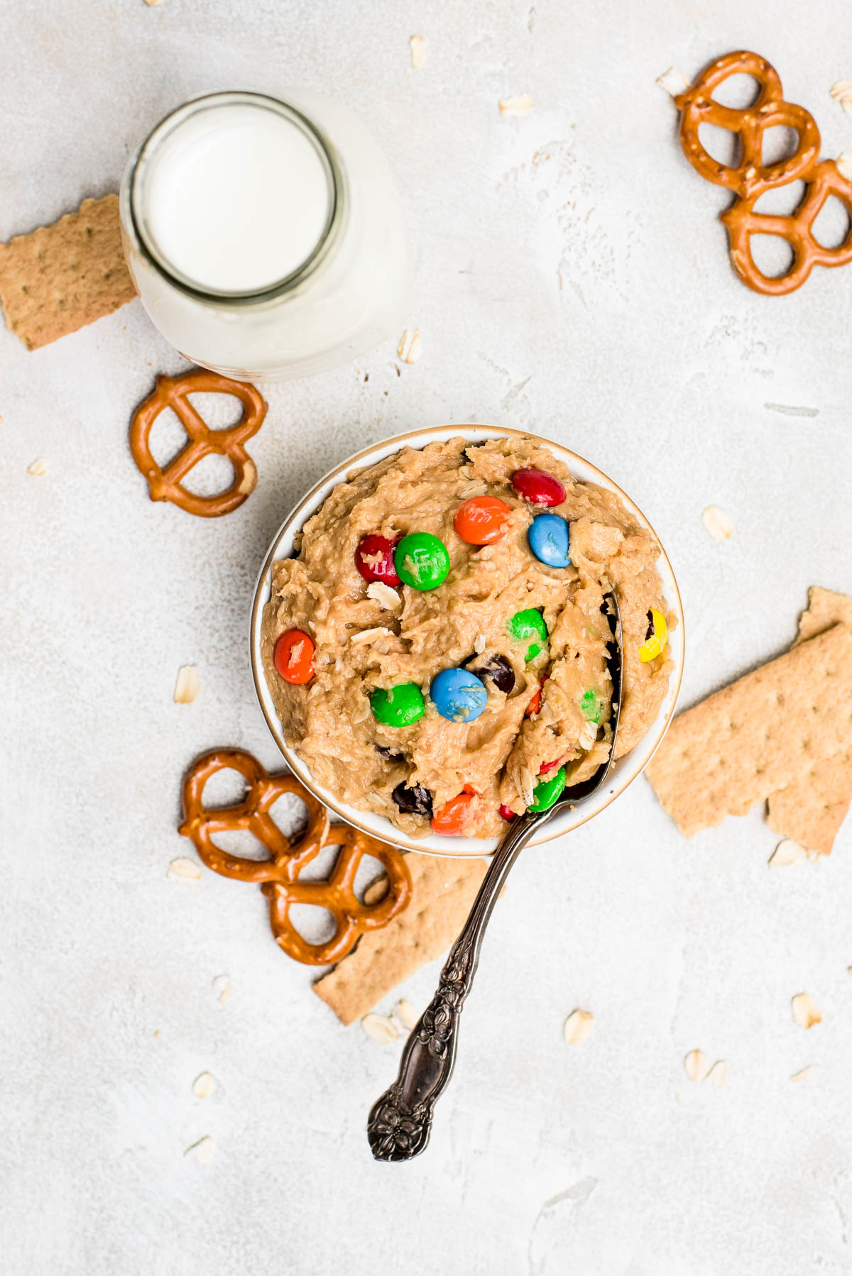 overhead monster cookie dough dip in bowl with spoon and food to dip