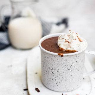 finished hot chocolate in mug with whipped cream