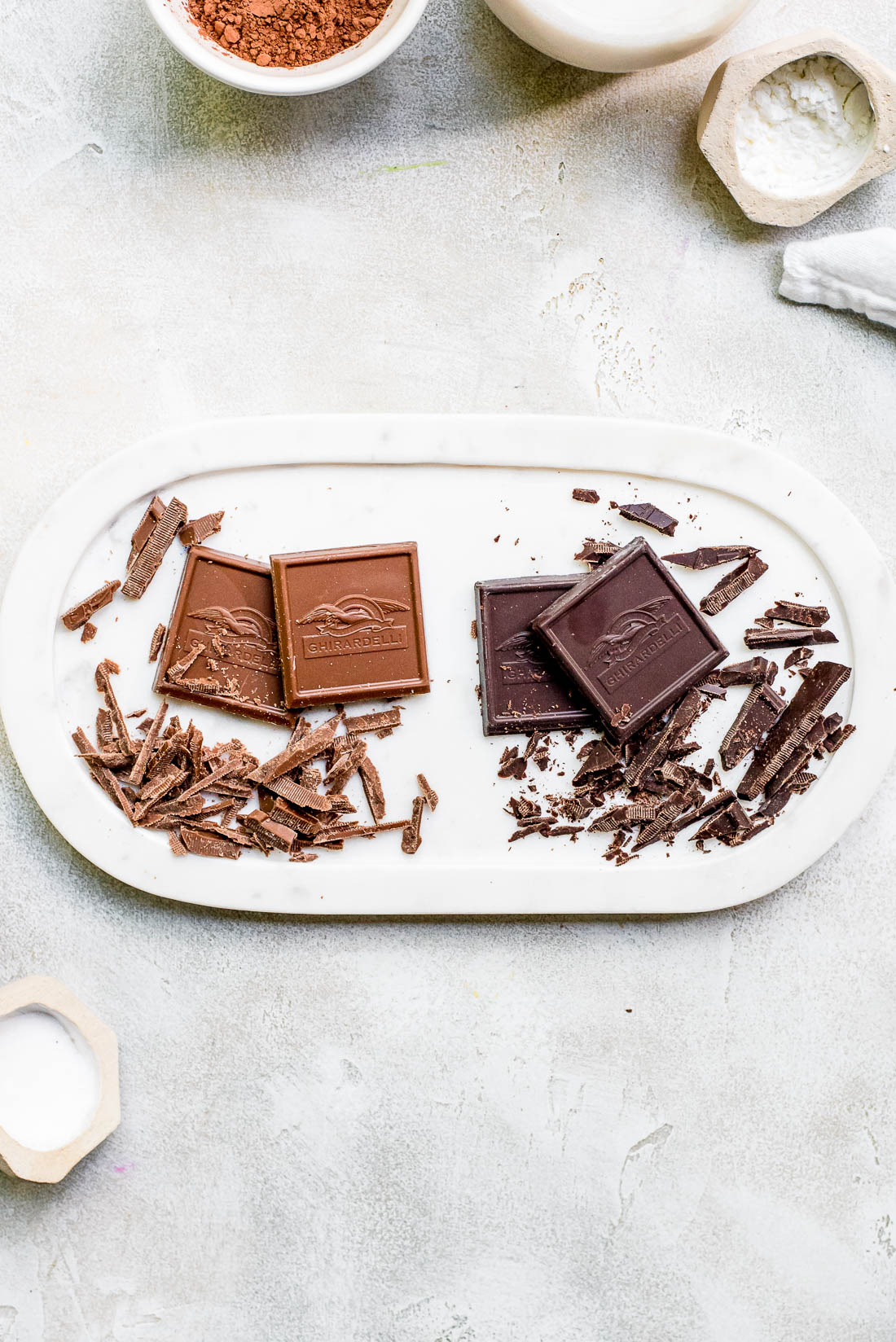 milk chocolate and dark chocolate pieces on tray