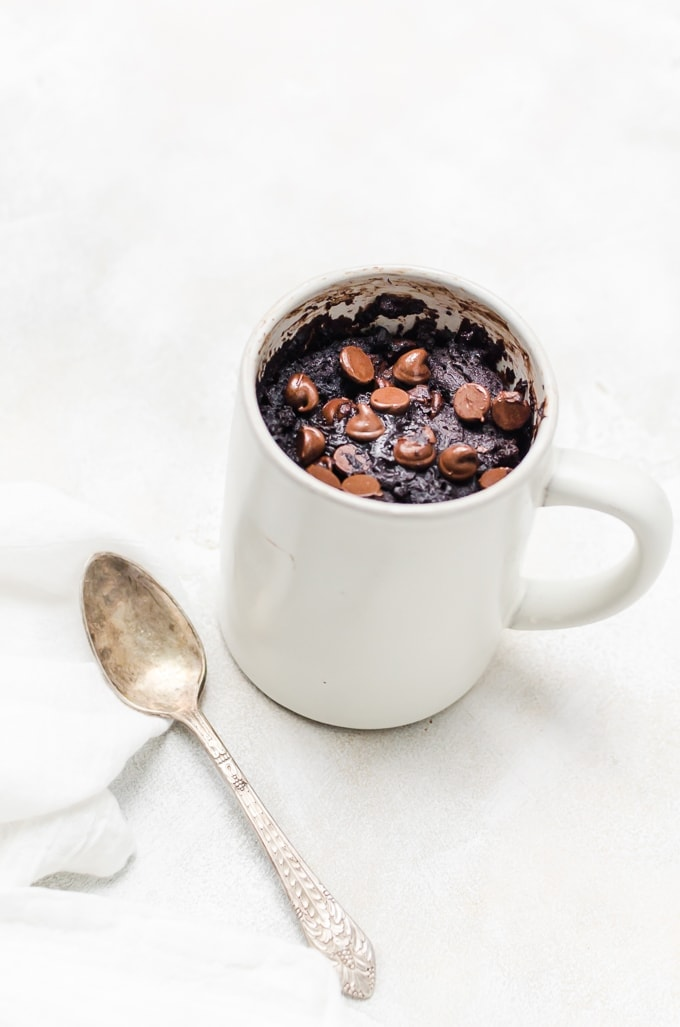 chocolate cake in a mug with spoon