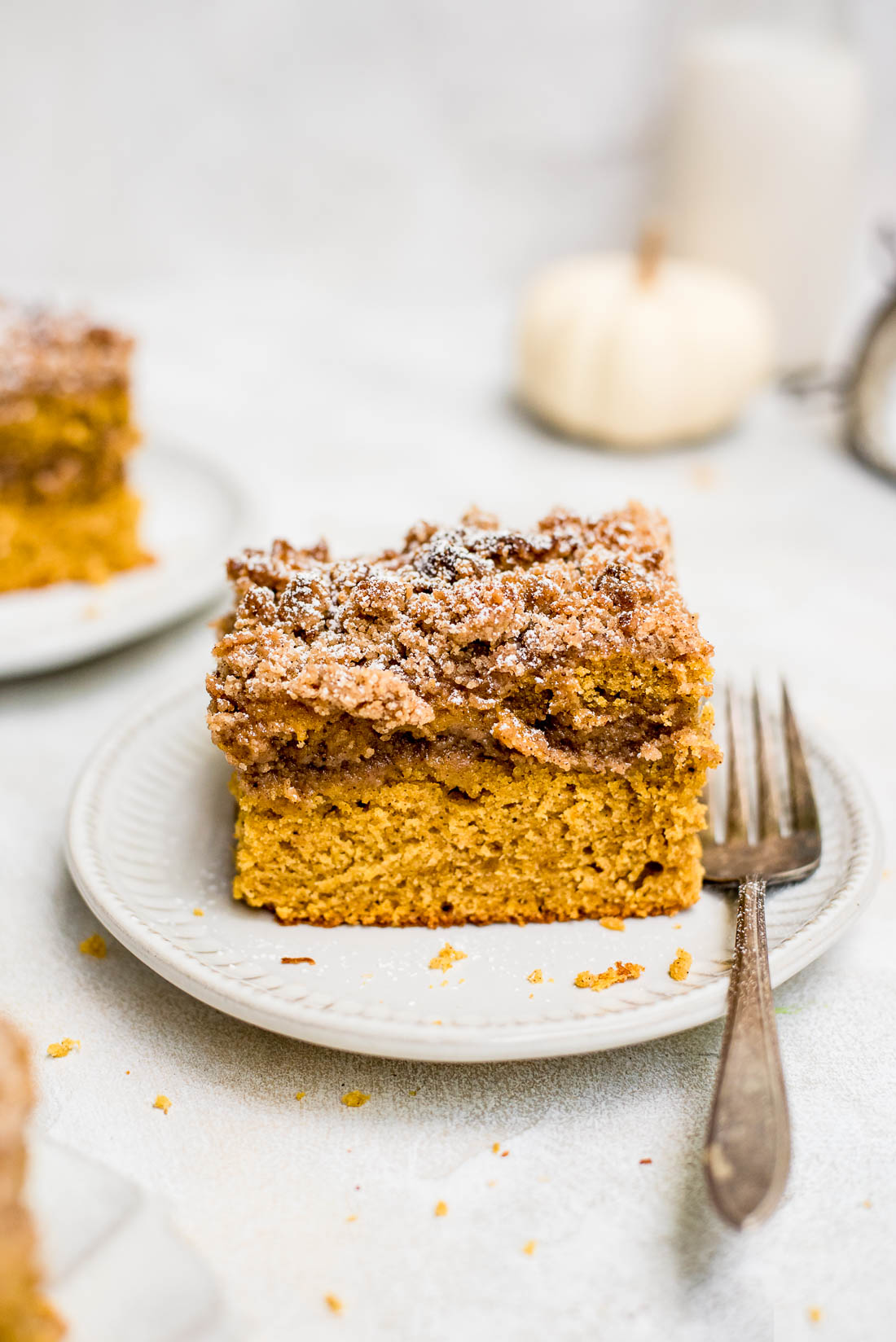 pumpkin coffee cake on small plate with fork on side