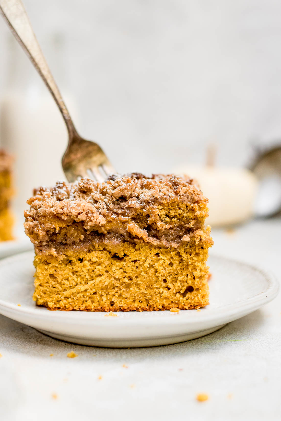 Close up pumpkin coffee cake with fork in cake
