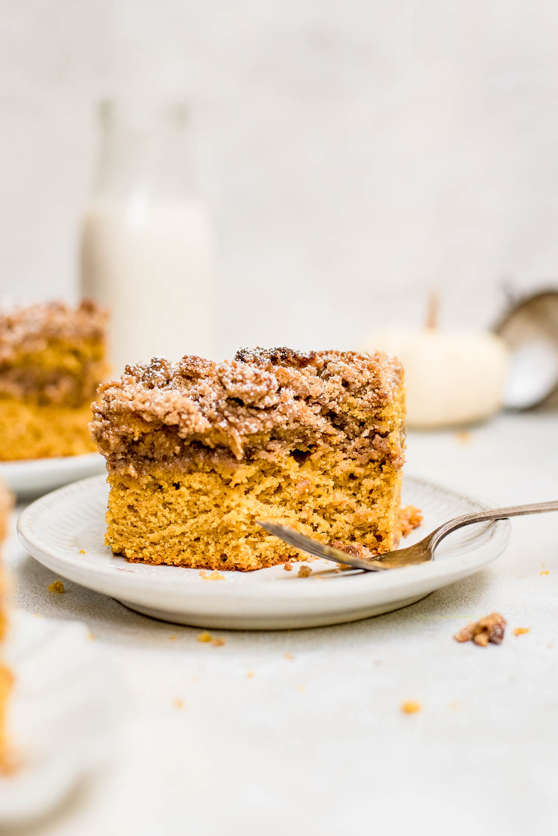 pumpkin coffee cake with piece of cake missing