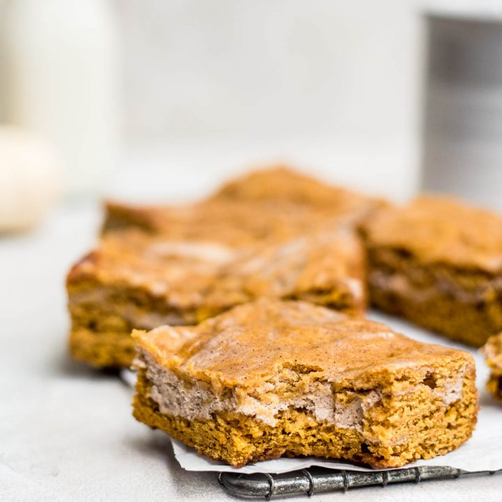 close up pumpkin cheesecake bars on wire rack