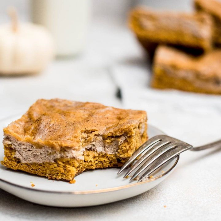 pumpkin cream cheese bars with fork on plate