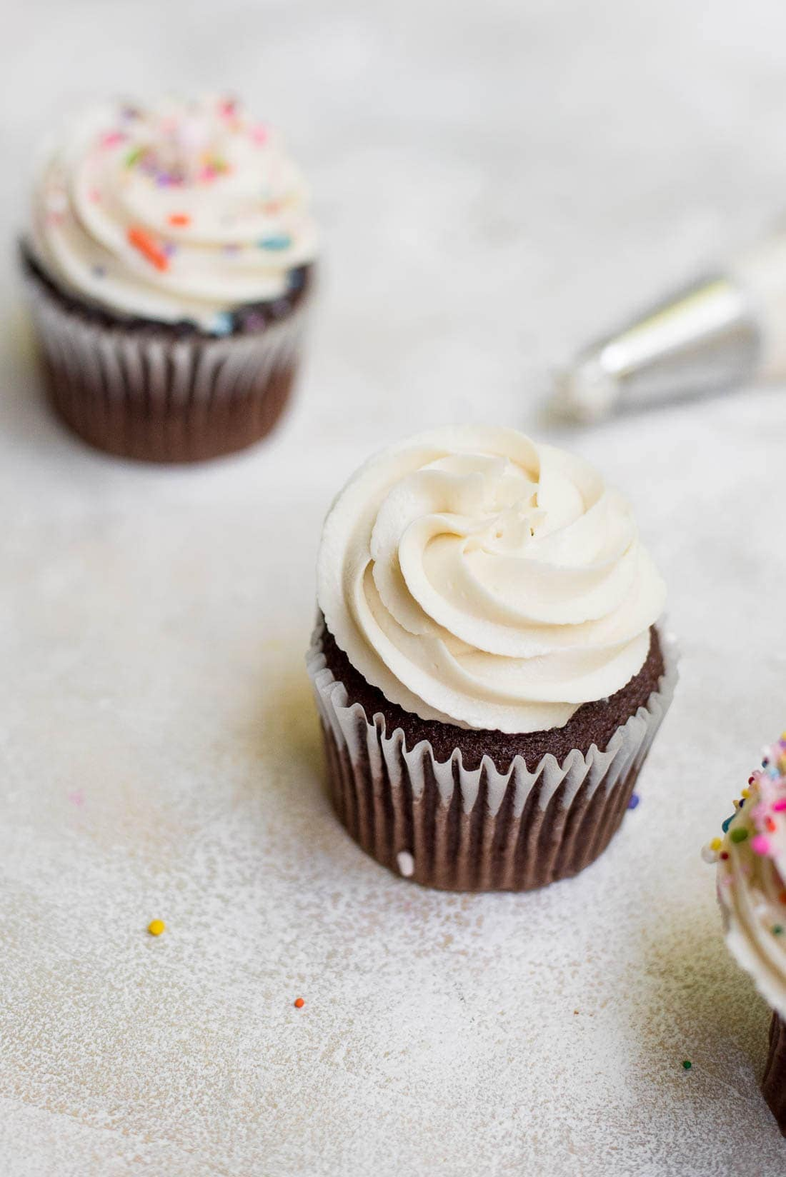 overhead of cupcakes topped with vanilla icing