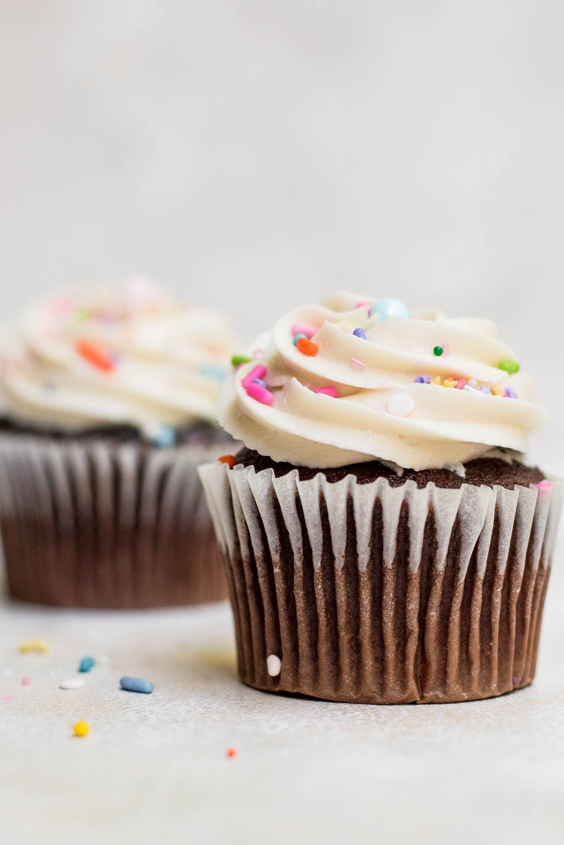 close up of frosting on cupcakes