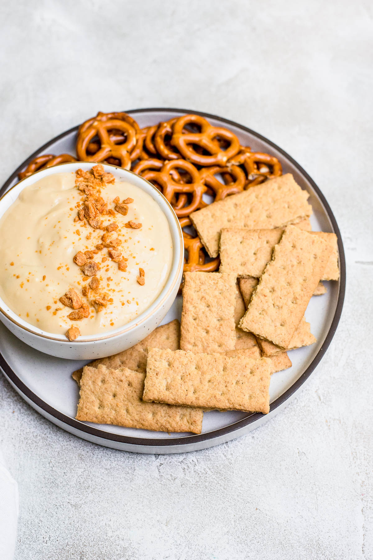 caramel apple dip on plate with graham crackers