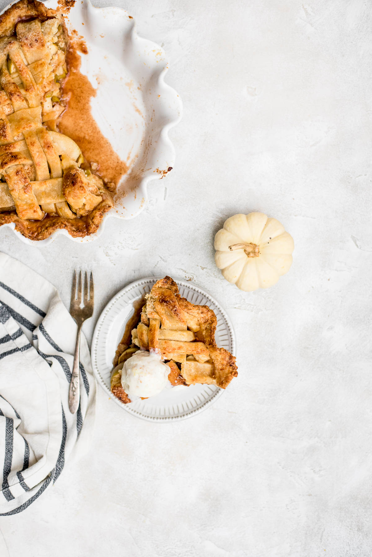 slice cheddar apple pie with ice cream on plate