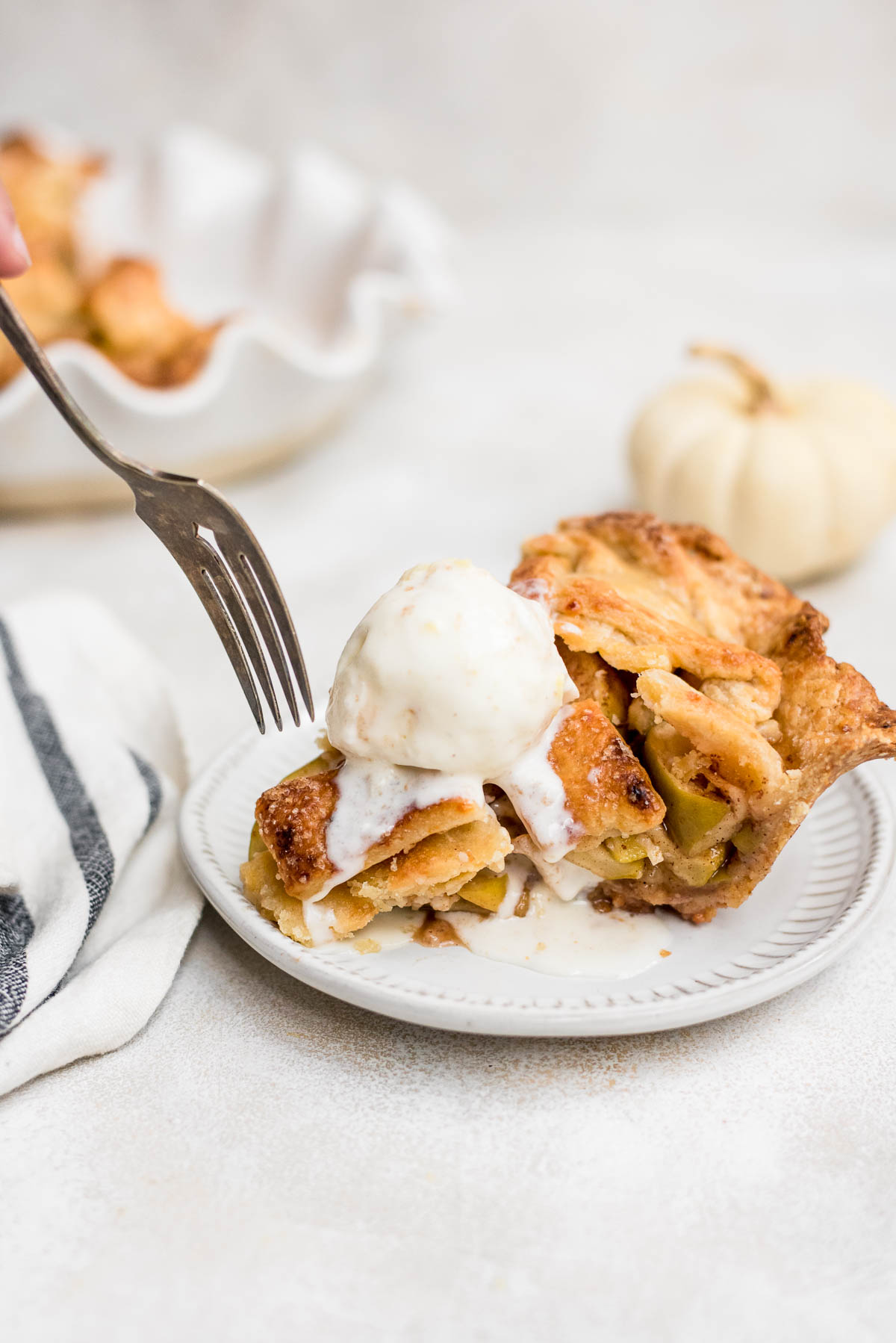 apple pie slice topped with ice cream