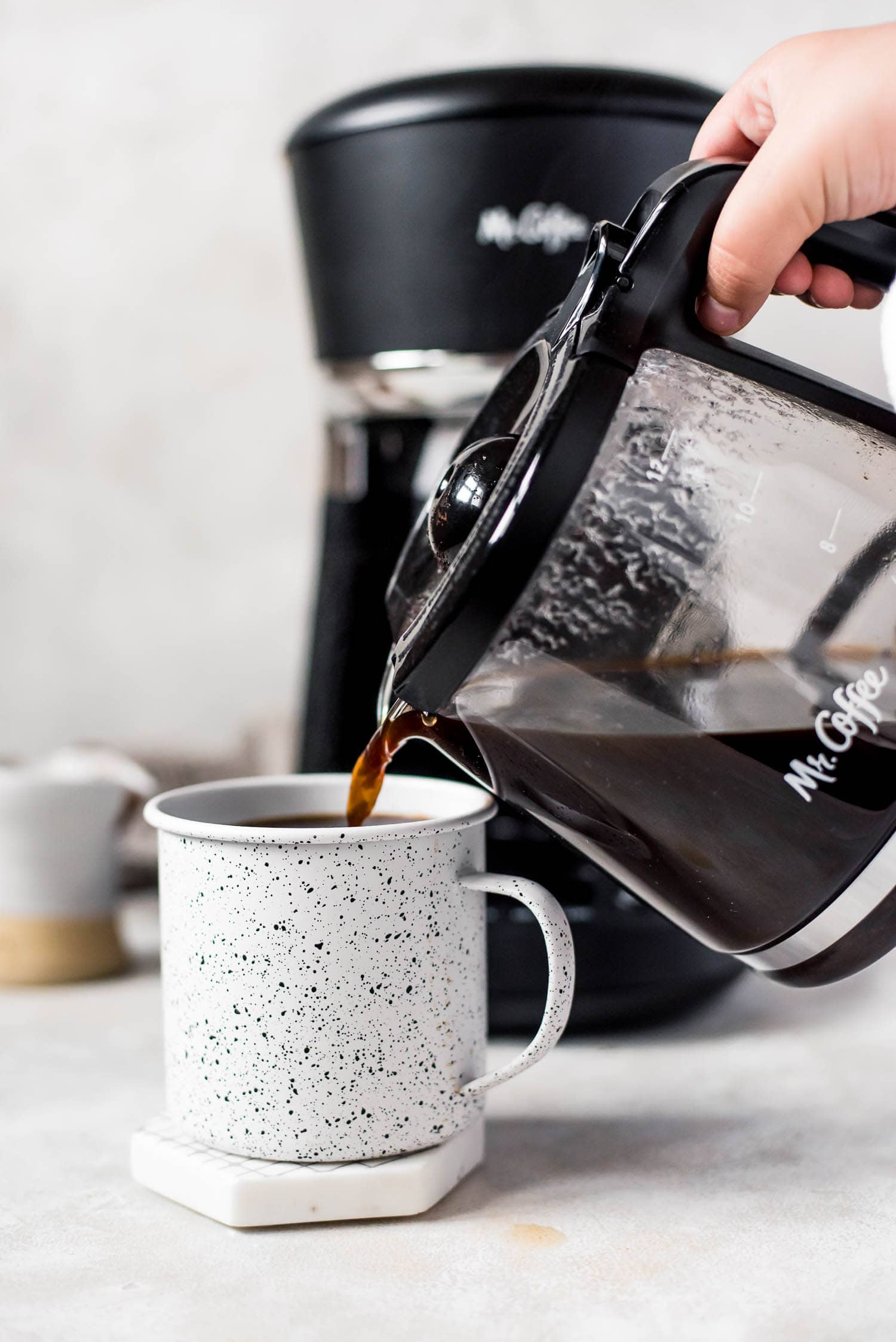 pouring coffee into mug