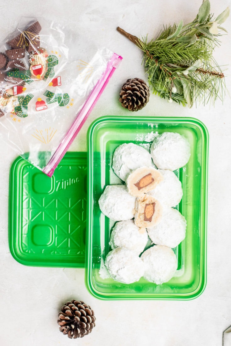 snowball cookies in green container