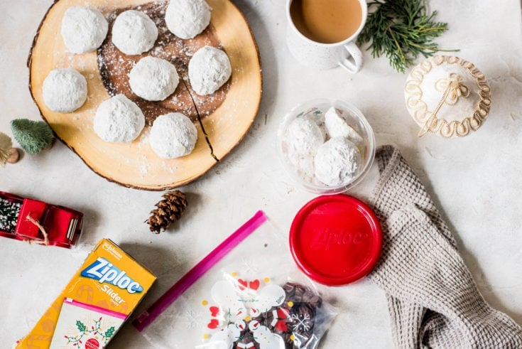 snowball cookies on wood board and coffee