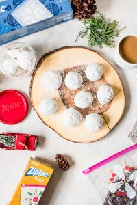 snowball cookies on wood board