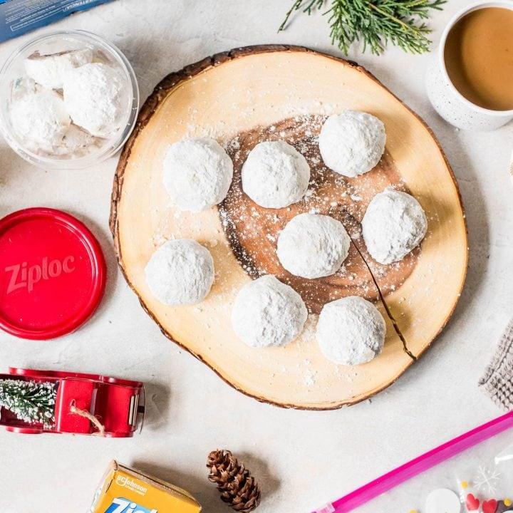 snowball cookies on wood board
