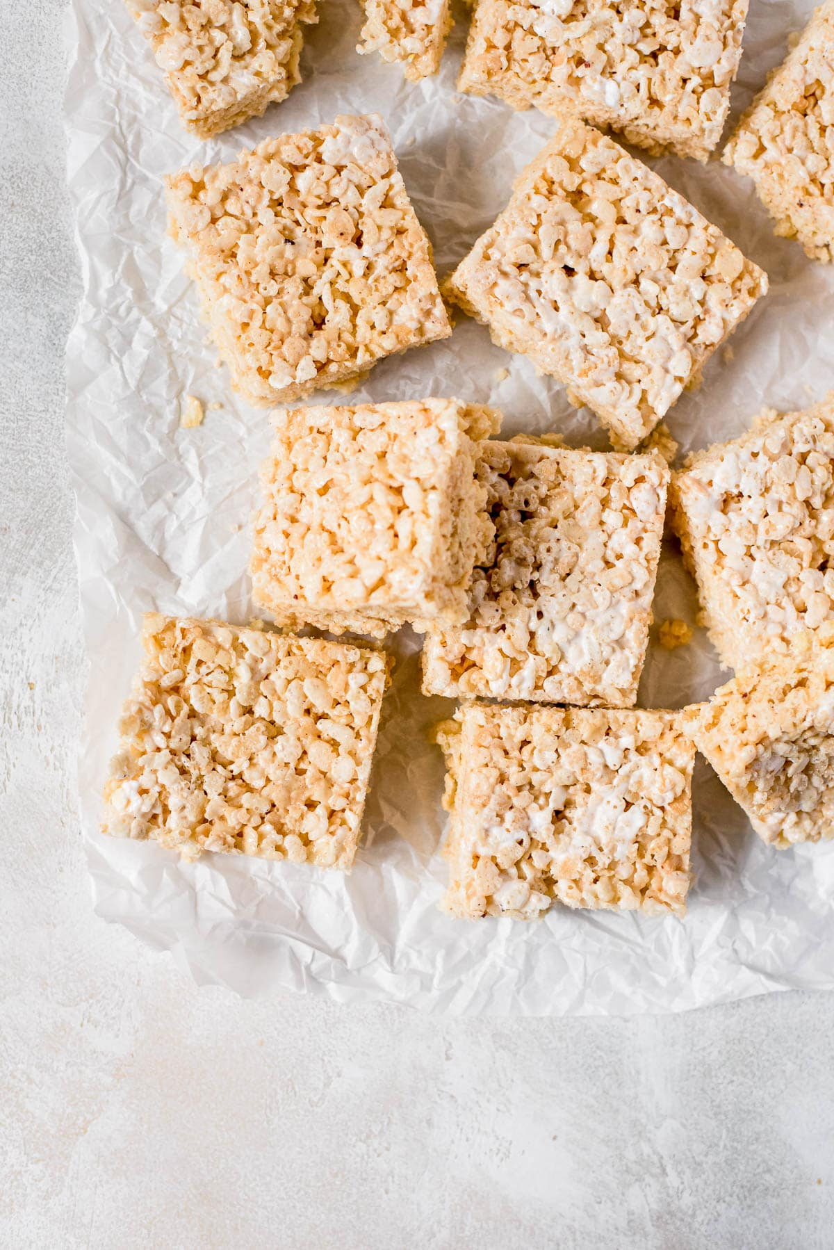 rice krispie treats scattered on parchment paper