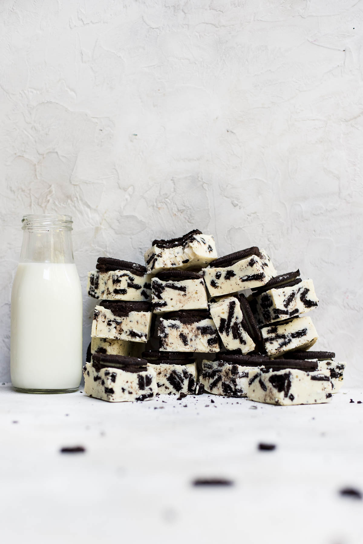 piles of oreo fudge against container