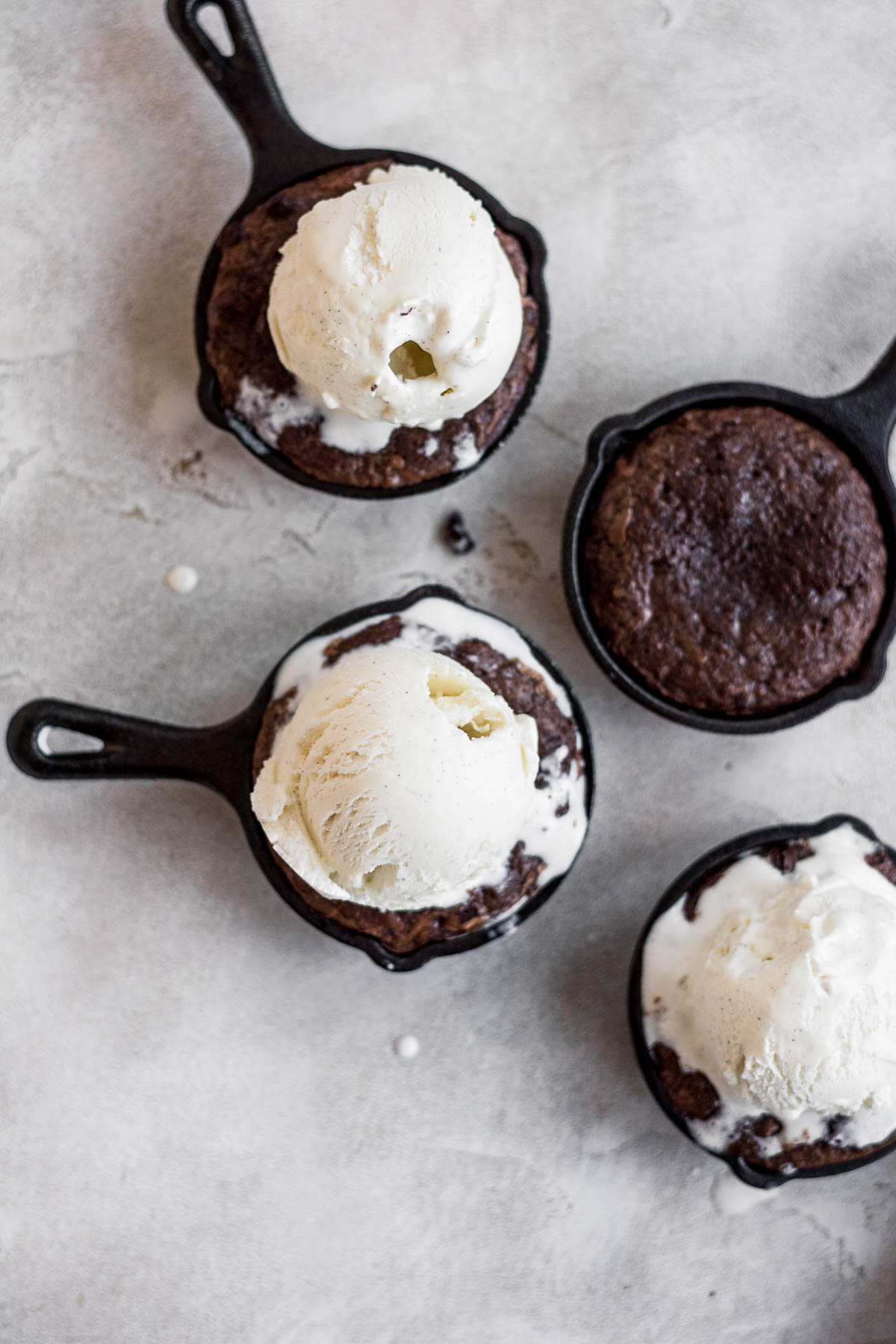 brownies topped with vanilla ice cream