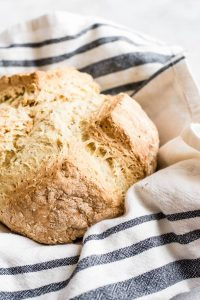 irish soda bread wrapped in tea towel