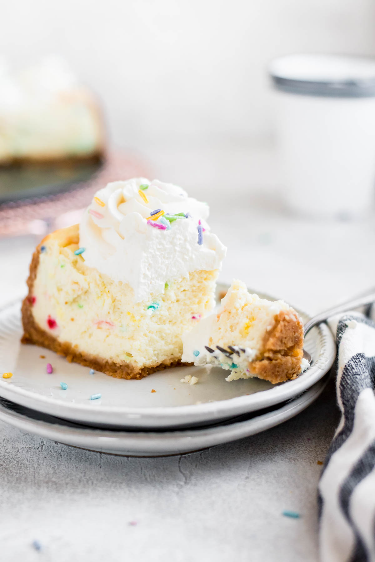 slice of cake batter cheesecake with fork